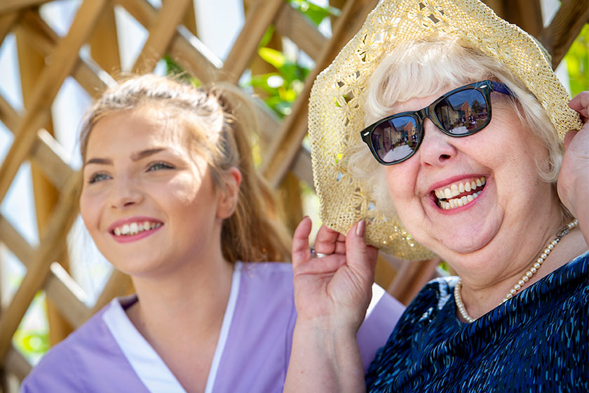 Sanctuary Care assistant and resident smiling